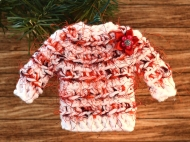 Sweater ornament in red and white with a ribbon flower