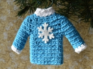 Sweater ornament in blue with snowflake