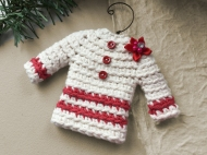Sweater ornament in natural white with charming red accents