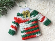 Sweater ornament in mixed Christmas colors with gold bow