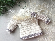 Sweater ornament in natural white with metallic silver trim