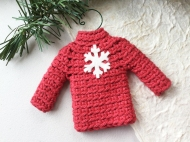Sweater ornament in red with snowflake