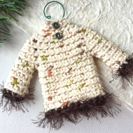 Sweater ornament in natural colors with groovy trim and tiny buttons