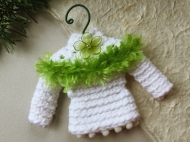 Sweater ornament in white with green trim and flower